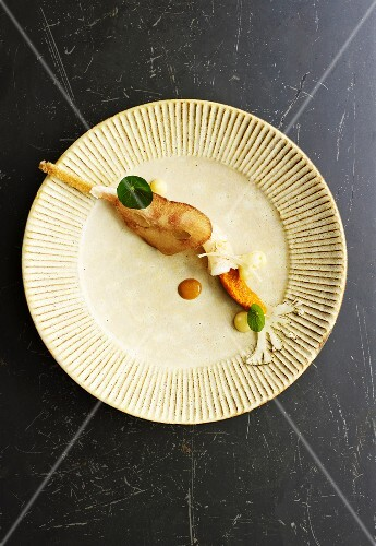 An arrangement of appetisers with langoustine