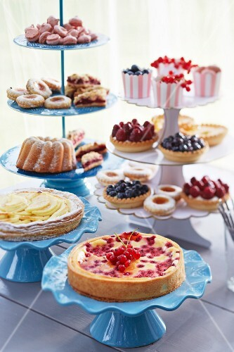 Various cakes, pastries and biscuits on cake stands