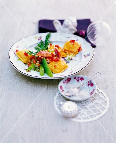 Ravioli with trout and vegetables on a table decorated for Christmas