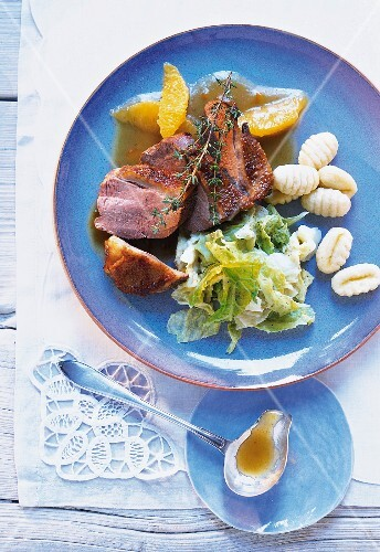 Goose breast with orange sauce, savoy cabbage and gnocchi