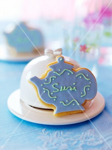 A homemade place card biscuits shaped like a teapot