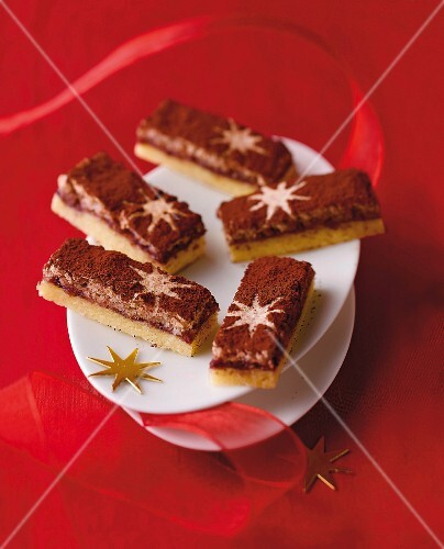 Almond-meringue slices dusted with cocoa powder and decorated with stars