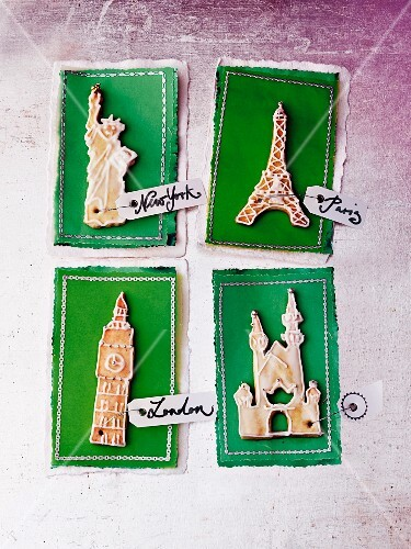Four travel vouchers decorated with iconic landmark biscuits