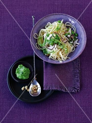 Lime spaghetti with a pea and mushroom pesto