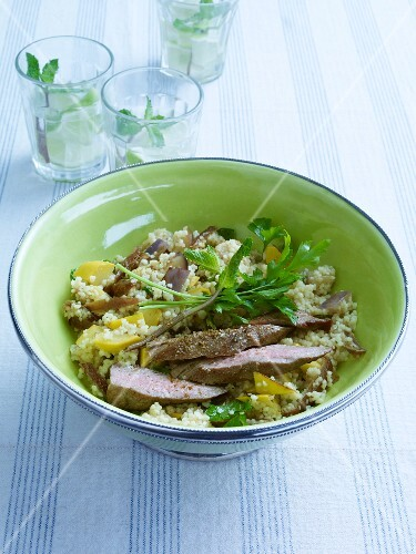 Couscous salad with lamb, aubergines and dates