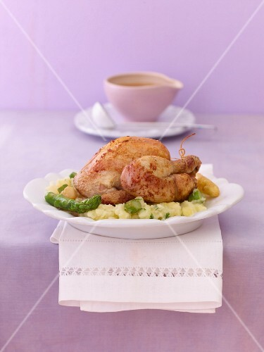Spring chicken with mashed potatoes and asparagus
