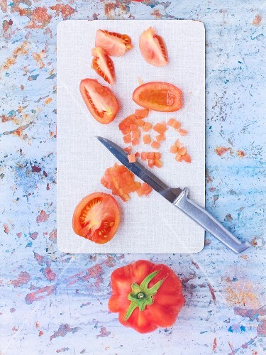 Tomatoes being chopped to make concassee