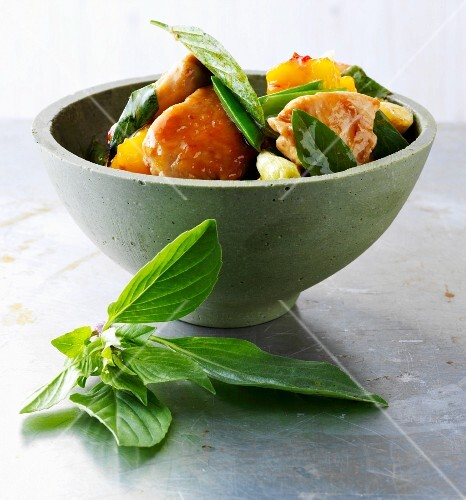 Stir-fried sweet-and-sour chicken with mango and Thai basil