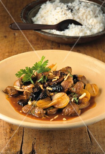 Andalusian–Chinese plum lamb with almonds and pearl onions