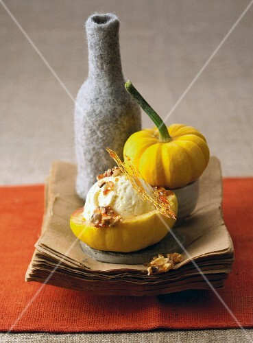 Vanilla ice cream with caramel lattice and walnuts served in hollowed-out pumpkin