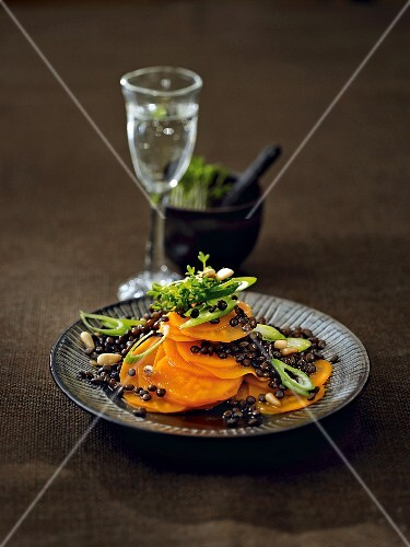 Warm lentil salad with sweet potatoes, leek and pine nuts