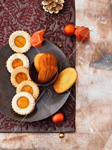 Cinnamon and orange shortbread sandwich biscuits and lemon-flower-honey madeleines