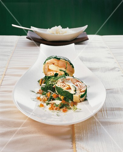 Stuffed char fillets with spinach on caviar with dill flowers