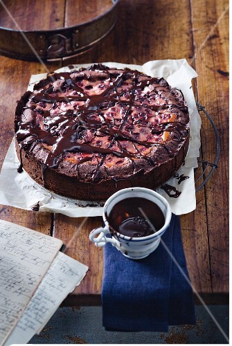Chocolate cake with cherries and chocolate glaze