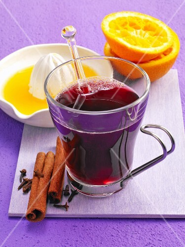 Mulled wine with cinnamon sticks, cloves and orange juice