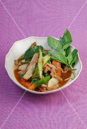 Veal with spring vegetables and Thai basil