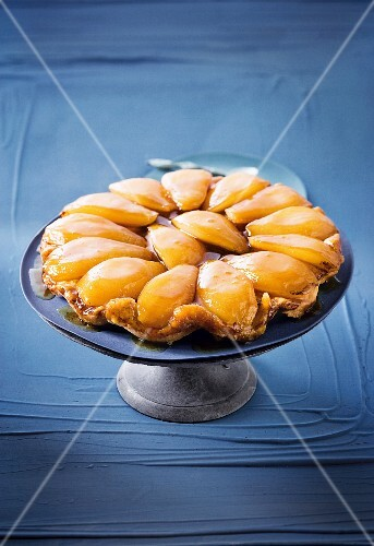 Caramelized short crust pastry with pears and butterscotch on serving dish