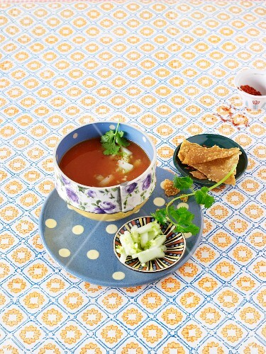 Cold tomato and melon soup with marinated melon and wontons