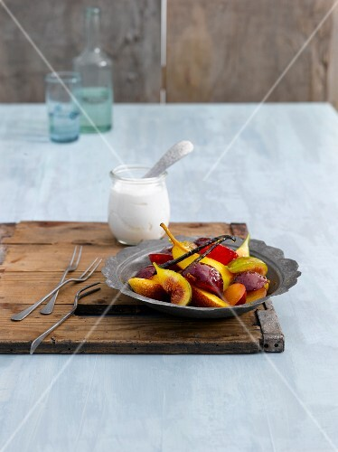 Fruits in honey syrup with yoghurt