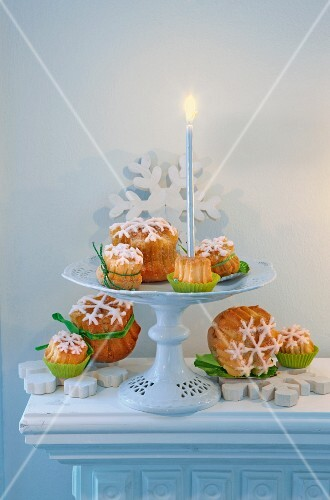 Lemon cake with snow-flake frosting and a candle