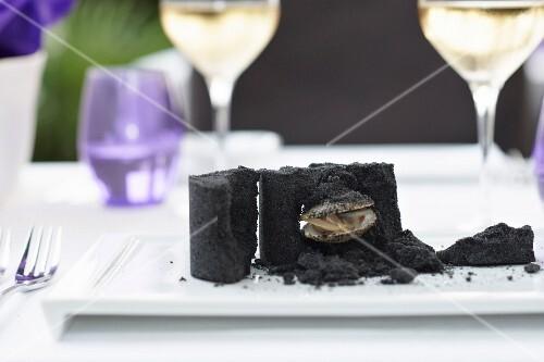 Sea truffles in black salt crust on tray
