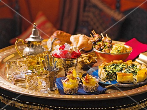 An Oriental buffet featuring main courses, bread and deserts