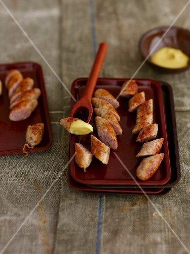 Sliced sausage with mustard