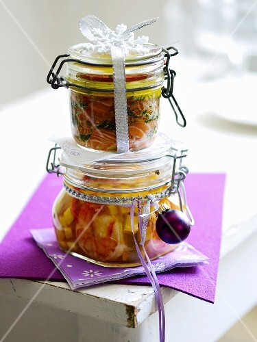 A jar of marinated salmon and a jar of preserved prawns