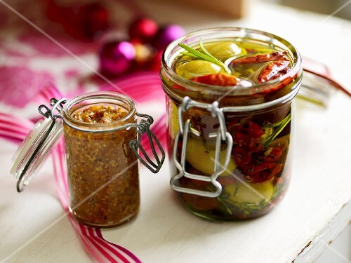 Jars of preserved olives and fig mustard
