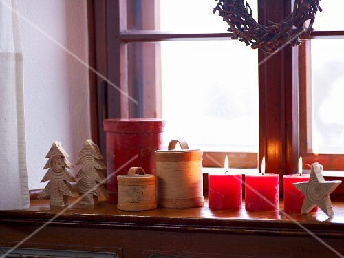 Christmas decorations with candles on the window sill