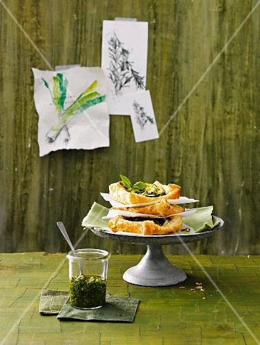 Vegetable puff pastry parcels with herb pesto