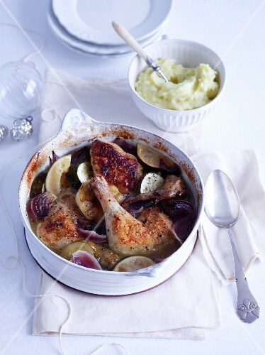 Lime chicken in a pot with a bowl of mashed potatoes
