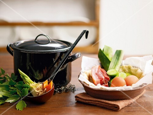 A pot and soup ingredients