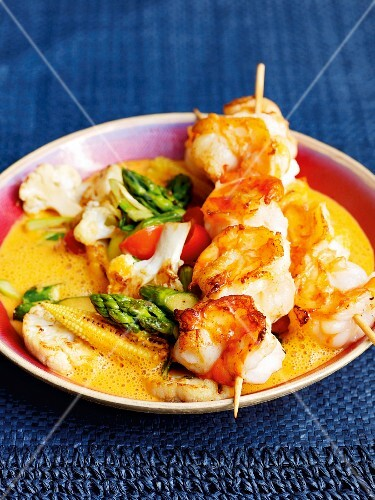Prawn skewers with a red curry sauce