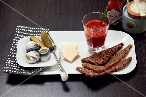 A hangover cure breakfast with rollmop herring and tomato juice