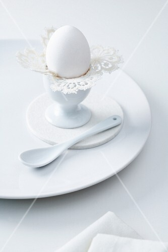 An old-fashioned doily as an egg cup decoration