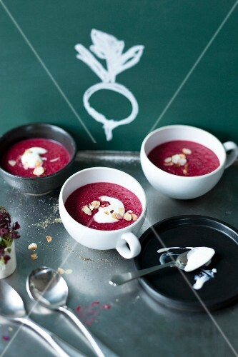 Cream of beetroot soup in small soup bowls