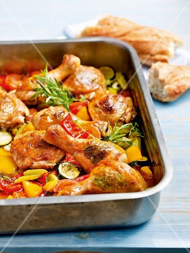 Chicken legs on a bed of oven-roasted vegetables
