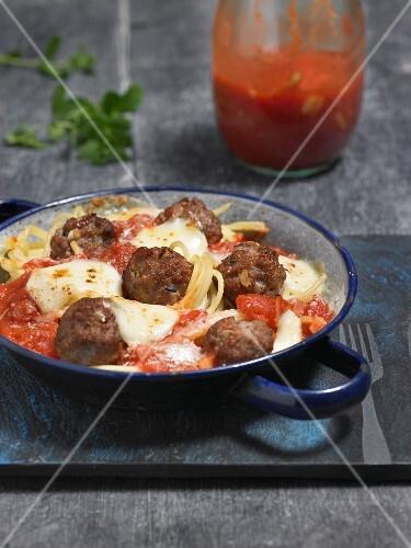 Spaghetti with meatballs, tomato sauce and mozzarella