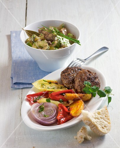 Braised cucumber and lamb stew, and meat patties with grilled vegetables