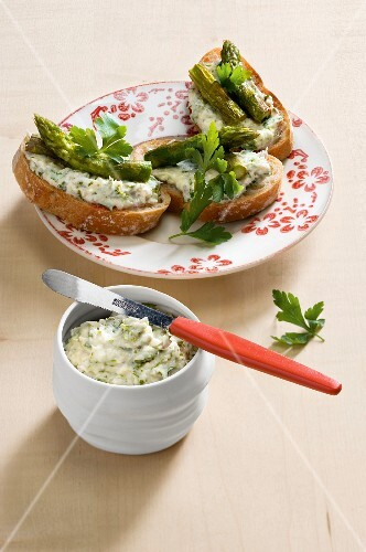 Bread topped with fish purée and fried asparagus