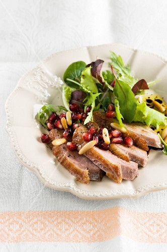 Mixed leaf salad with goose breast and pomegranate seeds