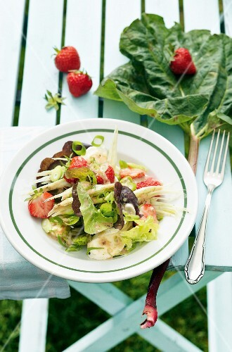 A mixed leaf salad with fennel, strawberries and a rhubarb dressing