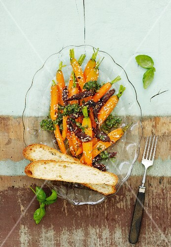 Roasted carrot salad with dried tomatoes, pesto and sesame seeds