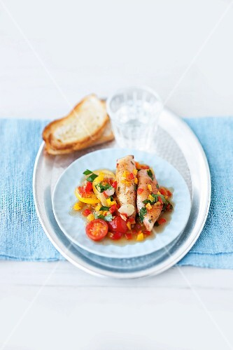 Fried calamari with a pepper medley and cherry tomatoes