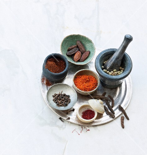 Various exotic spices on a tray