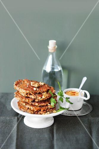 Carrot fritters with nuts and a soya dip with curry
