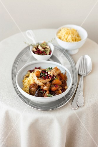 Aubergine ragout with apricots and pomegranate seeds on rice (Arabia)