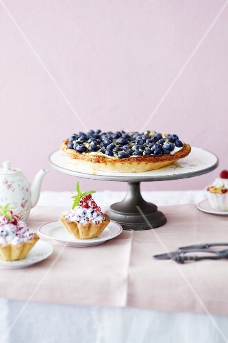 A blueberry tart with mascarpone and mini berry tartlets