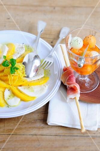 Peach caprese, and melon with ham grissini